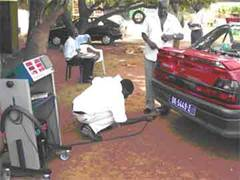 Gas and diesel emissions testing in Dakar.
